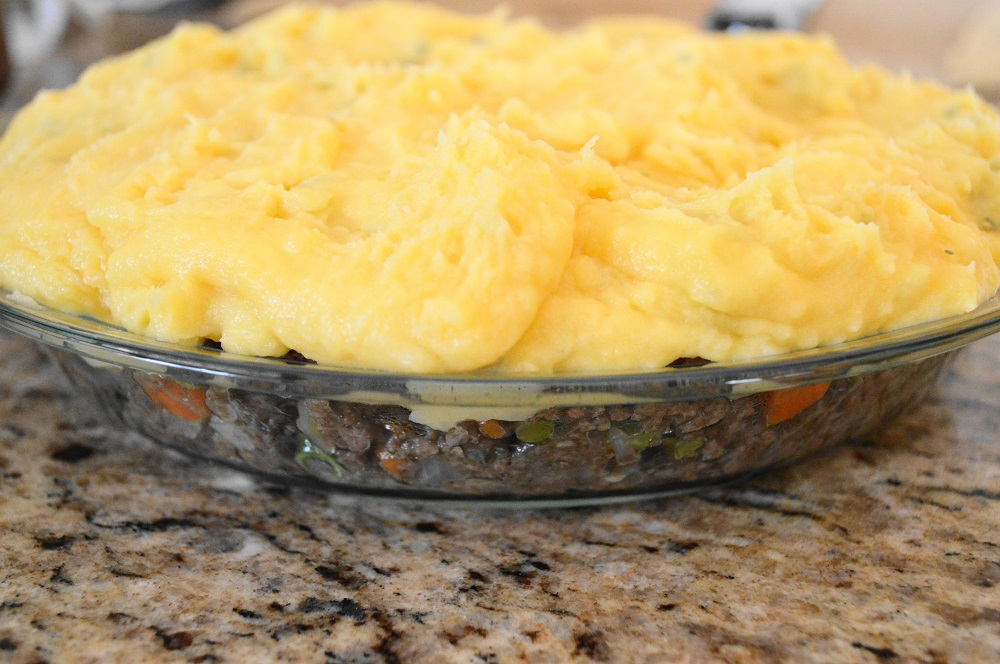 I used a 9 inch pie dish to assemble my shepherd's pie. That savory, beefy filling was packed in tight. Then I spooned those glorious and fluffy potatoes on top to seal in the filling.