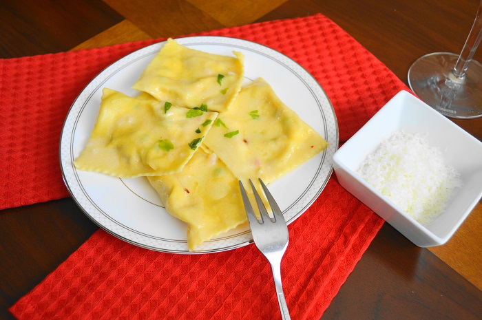 Pancetta and Pea Ravioli in Asiago Beurre Blanc.