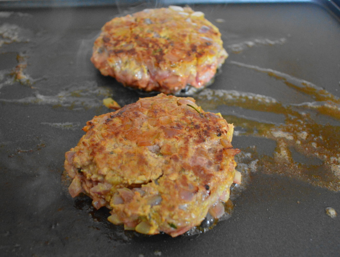 The lamb burgers getting gorgeously browned and cook through.