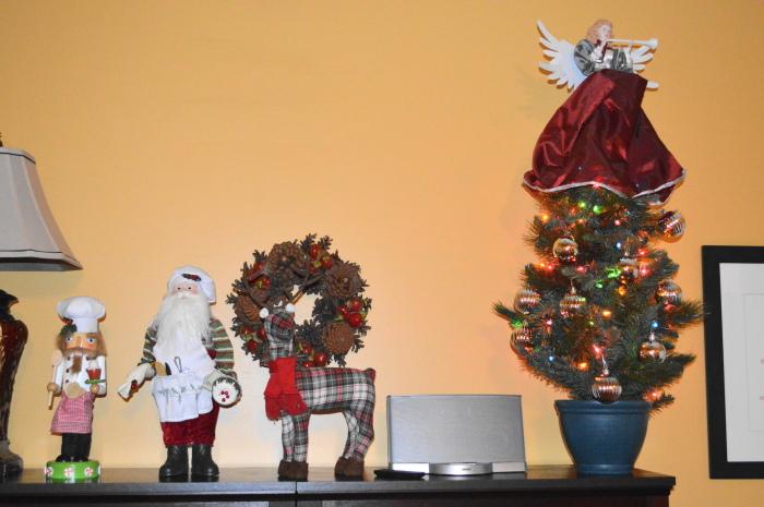 My Nana's wreath anchors the shelving decorations. I also love my Chef Nutcracker and Chef Santa!