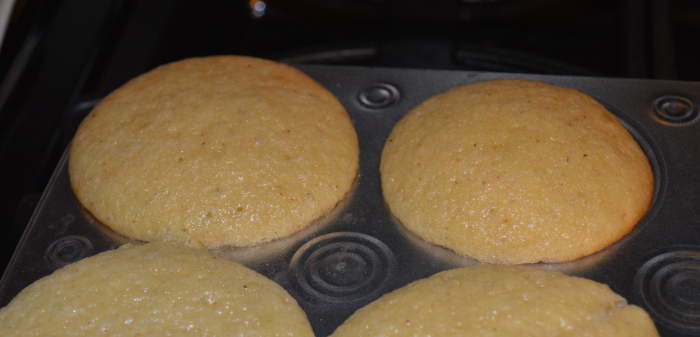 My pretty eggnog cupcakes all puffy and golden!