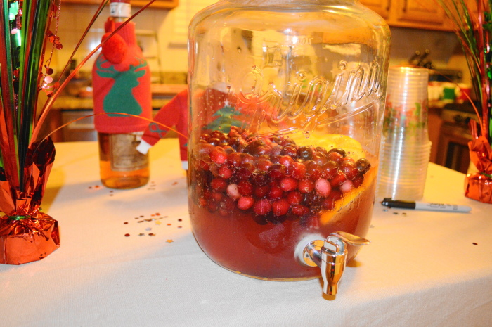 The festive cranberry orange fizzy punch. We set up the ugly sweater party bar on our kitchen island.