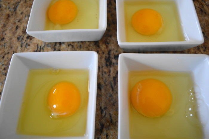 The most important part of eggs benedict is to have the yolks intact. Cracking them into individual bowls like this first helps make sure that happens!