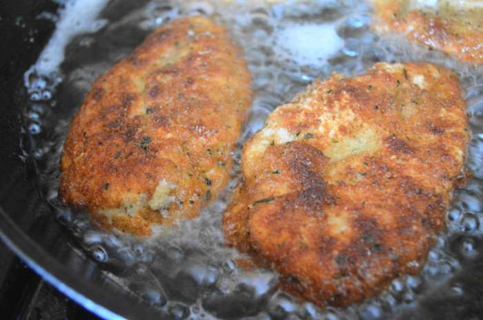 Pan frying the chicken parmigiana creates an incredible crust and protects the chicken from drying out when it bakes.