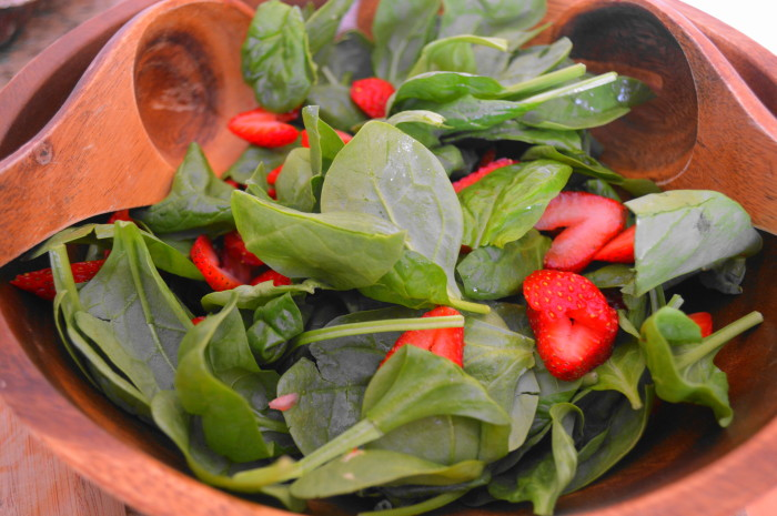 I love the bright red and lush green colors in this strawberry salad. You eat with your eyes first!