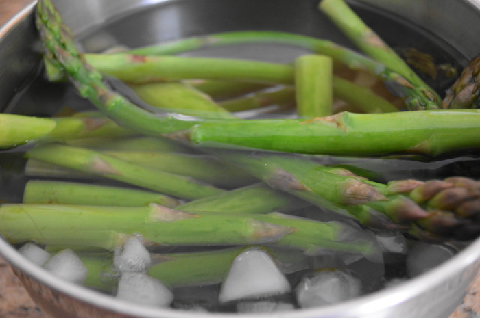 Blanching the asparagus before roasting makes it extra tender and gives it a more vivid green color.