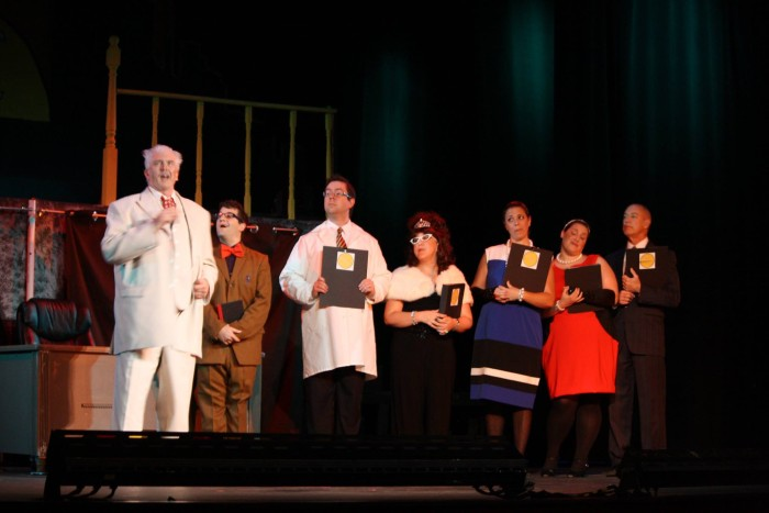The privileged rich workers of Urine Good Company, including the incomparable Greg Newton as Caldwell B. Cladwell. That's my cute Marc in the lab coat and I'm next to him with the major wig!