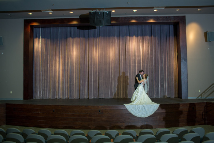 We had our wedding photos taken at the theater where we did our first show as a couple. It was perfect!