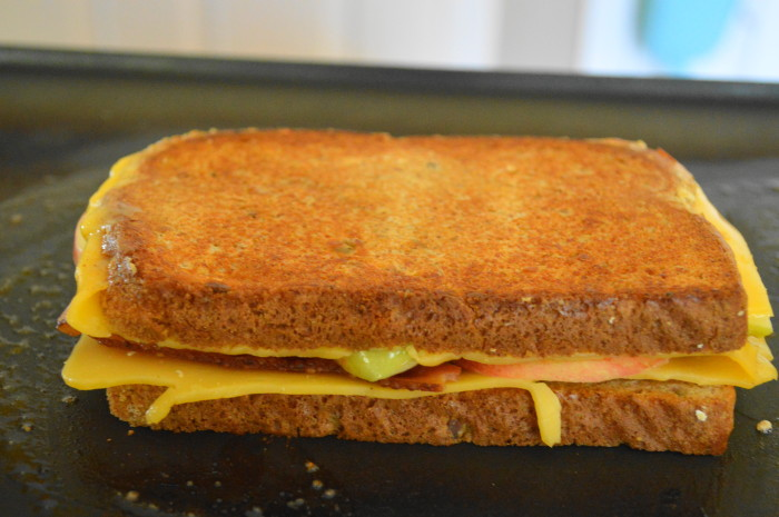 The assembled apple cheddar bacon grilled cheese sandwich went onto my buttered electric griddle to get nice and brown on each side. The cheese became gloriously melty and just oozed all over the rest of the ingredients.