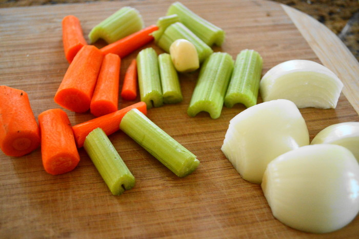 The aromatics were the key to my homemade chicken stock. I used carrot, celery, onion and garlic for loads of flavor.
