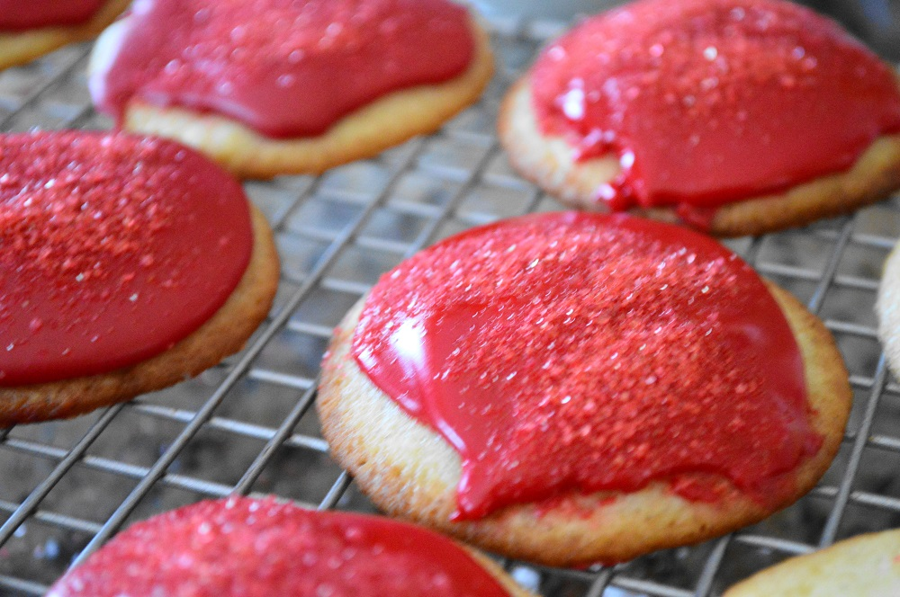 The cooled mascarpone rose cookies each got a small spoonful of the glaze on top and then a sprinkling of red sugar before the glaze set. They looked like sparkly rubies, I was so excited!
