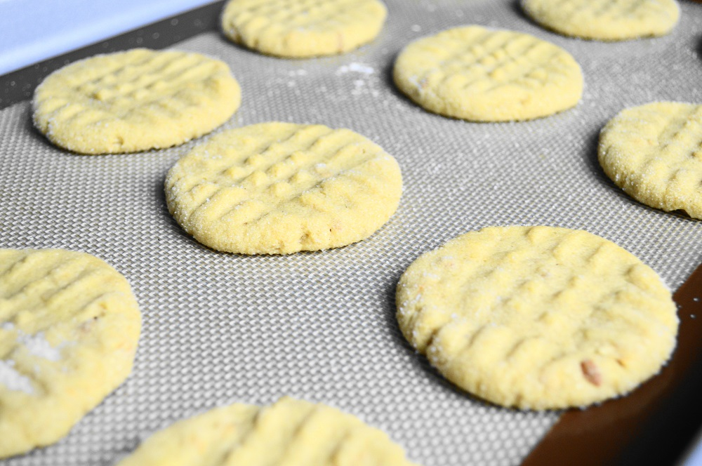 The peanut butter cookies needed to bake for 12 minutes to get perfectly golden. I baked them in batches of two trays at a time. Rotating them halfway through ensured they would bake evenly!
