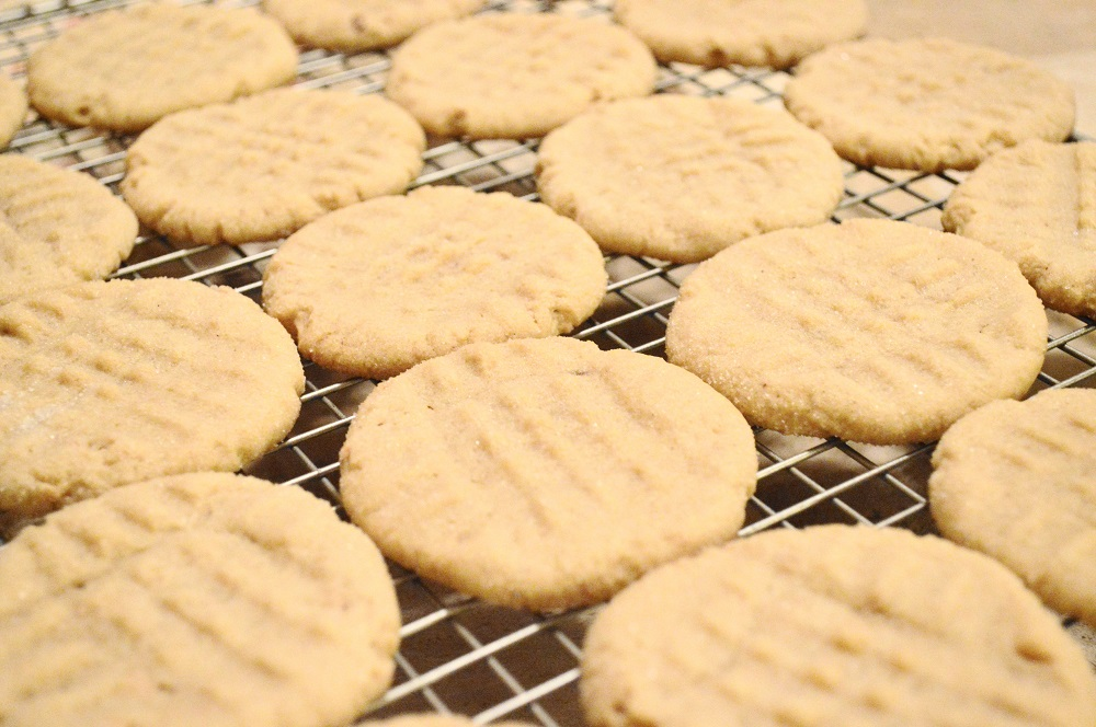 After the peanut butter cookies cooled a little on the trays when they were done, I transferred them to cooling racks so that they wouldn't bake any more. When they were completely cooled I packed them up and hid them from hubby so that some would make it out the door to give. Ha!