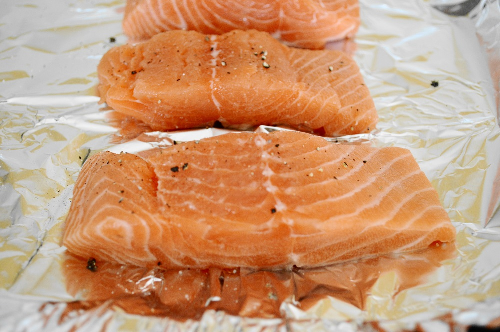First I laid out my salmon fillets on a lined sheet tray and seasoned them. For this recipe, I had my fish monger cut me 6 ounce fillets and remove the skin. The skin is no good in broiling, it turns to mush.