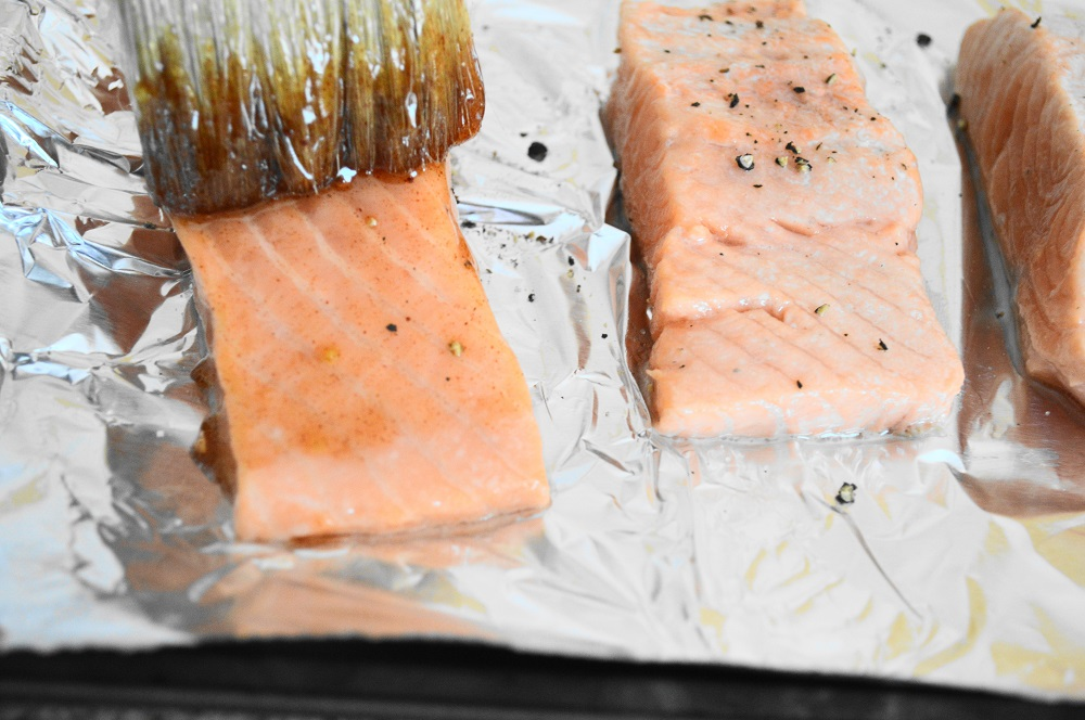 After the first round of broiling, it was time for the big flavor. I mixed maple syrup, bourbon, ground mustard and smoked paprika together thoroughly. Then I brushed that mixture all over the salmon fillets.