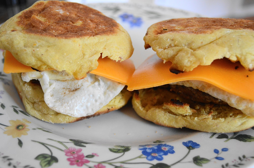 Once the eggs were cooked I quickly assembled the homemade breakfast sausage sandwiches. I wanted to make sure everything was hot. I layered the sausage patties first, then the eggs, and finally a slice of extra sharp cheddar. It started to melt right on the hot egg!