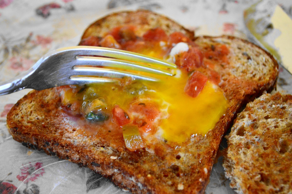 I topped each spicy egg in the hole with a spoonful of salsa. Then it was time for my favorite moment in eating. It's a thing with me. I cut into that perfectly cooked egg yolk and it ran all over the toast. The way it mingled with the salsa made me so happy. It was such an incredible and simple breakfast to warm us up! xoxo