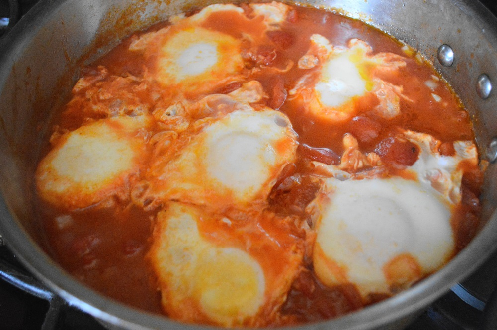 The eggs needed to poach with the pan's lid on for just 2 to 3 minutes to set. I told you this eggs in purgatory was a fast dish!