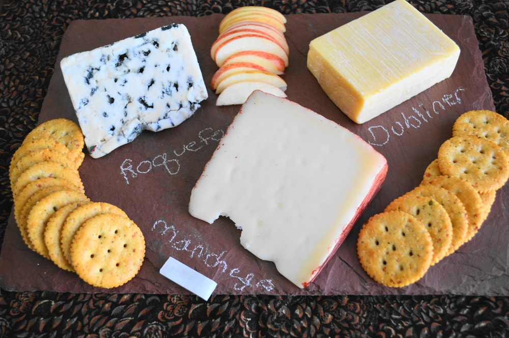 I am in love with the cheeseboard I got from uncommon goods. It's a heavy duty and durable slate with a gorgeous color to set off the cheeses. It came with chalk to label the cheeses so everyone could easily identify them too! I always like to do at least three different cheeses with crackers and some kind of fruit. This time I did a roquefort, manchego (my fave!) and because it's almost St. Patrick's Day, Dubliner cheese. Apple was perfect in this case because its sweetness mellowed the roquefort perfectly.