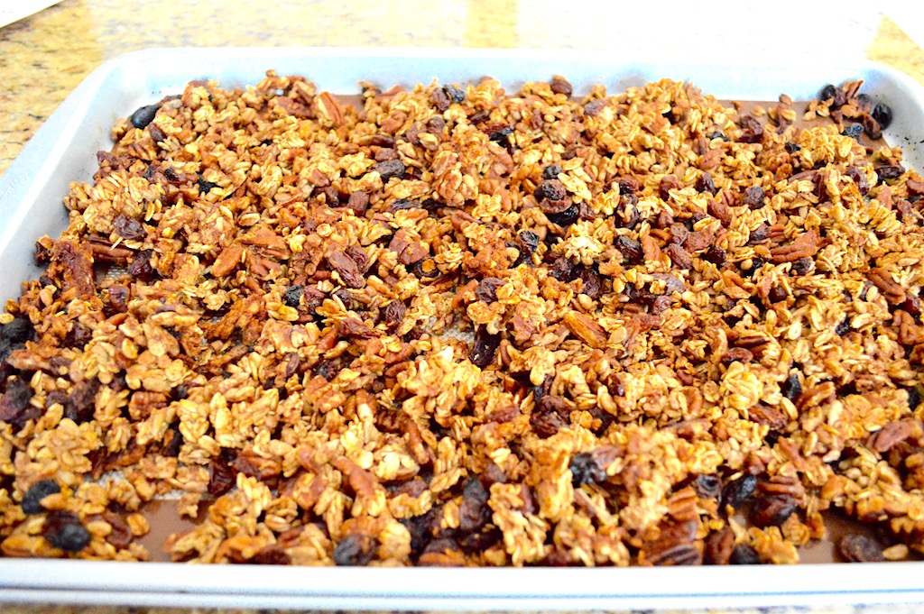 Once the maple pecan granola was done baking, it was so golden and gorgeous! It also made the whole house smell incredible with all of the cinnamon I used. I released it all from the mat and gave it a good toss. Then it went back into the turned off oven. The oven was still hot without being on. That dried out the granola without baking it further. Drying it out was important to make it crumbly and crunchy!