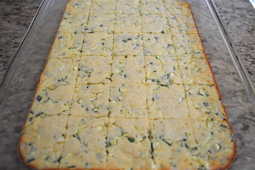 I could tell the zucchini squares were done when they just started to brown around the edges and become golden on top. After I let them cool for 20 minutes, I just cut them into 30 squares. That meant cutting 4 equal lines down the length of the pan and 5 equal lines down the width. That made them the perfect party size!