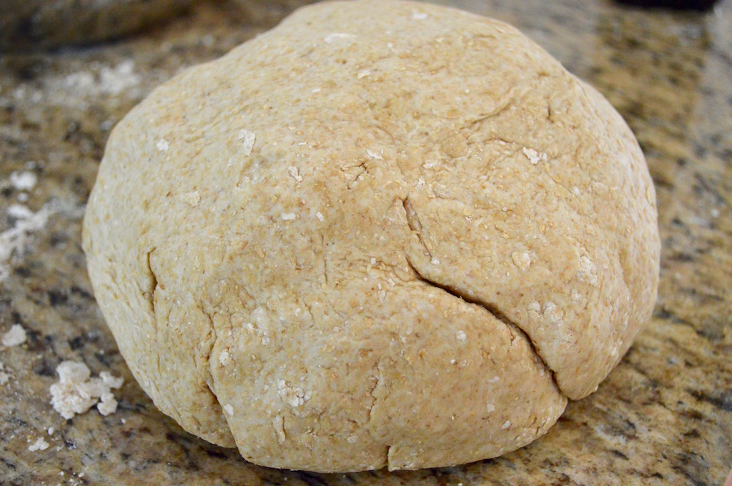 The dough for the whole wheat pita bread came together quickly. All I did was stir whole wheat flour, regular flour, active dry yeast, salt, olive oil and water together in a big bowl to turn it into a soft dough. It was important for the water to feel like bathwater to activate the yeast! Then I kneaded it for 10 minutes to make it super elastic and springy.