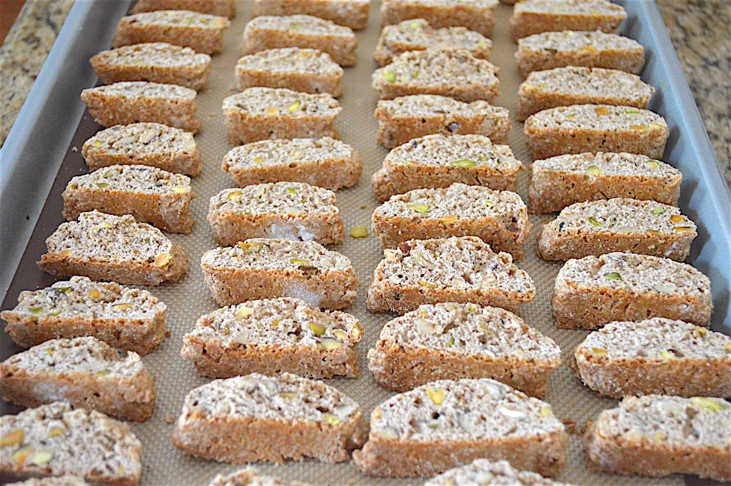 I sliced those logs into roughly 1/2 inch thick pieces. They were so cute and perfectly shaped! Once I sliced the hazelnut pistachio biscotti, they needed to bake again to crisp up the interior. It gave them that signature crispy texture!