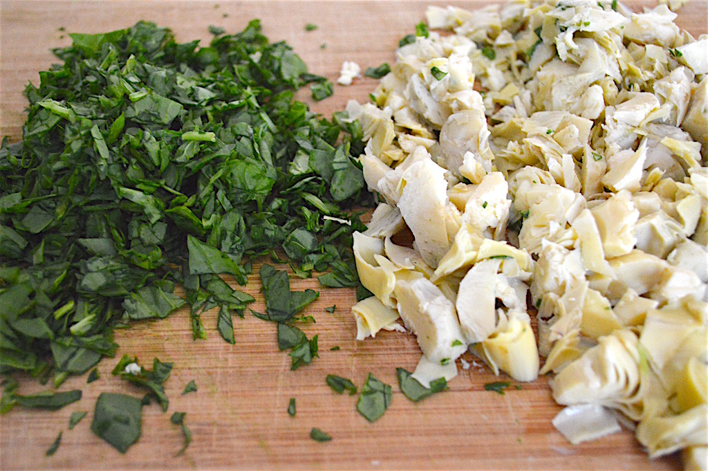 First, I just quickly chopped a whole bunch of fresh baby spinach and jarred artichoke hearts that I drained. They gave the spinach artichoke dip pasta so much texture and flavor! There is something about the way they compliment each other that just works so beautifully.