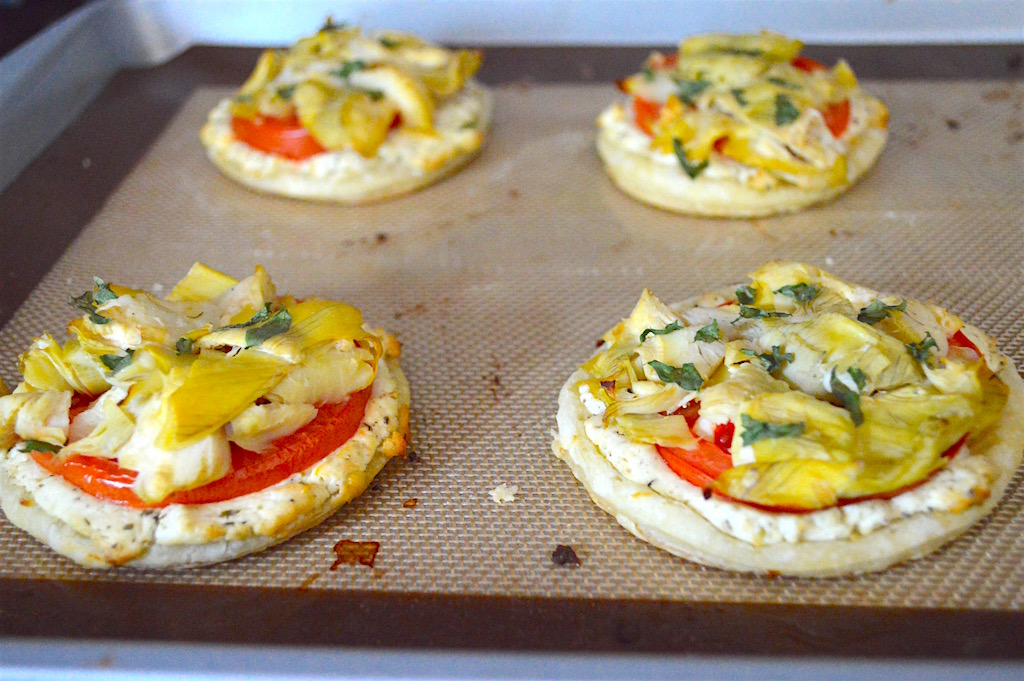 The artichoke, tomato and goat cheese tartlets baked for 25 to 30 minutes! The puff pastry became all crispy, flaky and glorious while the goat cheese got all melty and gooey. It was perfection! These babies were best served immediately.