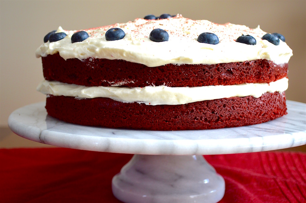 I topped off the red velvet cake with blueberries to almost look like the flag. Then I sprinkled shaved chocolate and red crystallized sugar on top! It looked so pretty and tasted even better than it looked. The cake was incredibly tender with that decadent cream cheese frosting. Hope you all enjoy this July 4th ready dessert! xoxo