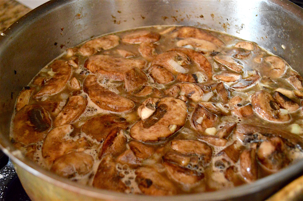 After I browned the chicken for a couple of minutes on each side, I set them side and started on the sauce for the chicken marsala. The flavorful base that the chicken left behind was the perfect sauce starter! I used loads of meaty, amazing cremini mushrooms with aromatics, marsala wine and chicken stock. When it all melded together it was absolutely glorious!