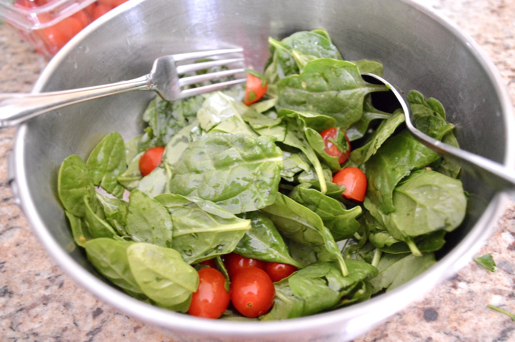 While the chicken sat in the marinade, I made a simple salad to top the chicken shawarma. I just tossed lots of baby spinach, grape tomatoes, cilantro and lemon juice together. It had so much bright, fresh flavor on its own!