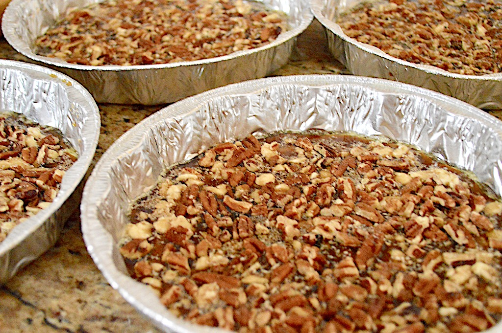 I divided that glaze among four well greased cake pans. Then I sprinkled a layer of pecans into each pan and pressed them into the glaze.