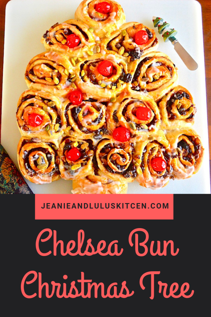 This is such an amazing and gorgeous Chelsea bun Christmas tree with lovely mincemeat filled sweet rolls formed into a tree. It gets decorated with orange flavored icing, cherries and pistachios for a festive Christmas morning!