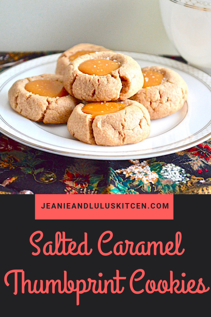 These salted caramel thumbprint cookies are such a fun and yummy part of any holiday baking with the deeply flavored cookie crust and luscious filling! #cookies #holidaybaking #saltedcaramel #saltedcaramelthumbprintcookies #jeanieandluluskitchen