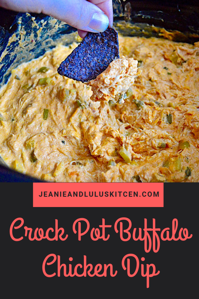 This is such a hearty and simple crock pot buffalo chicken dip to really spice up game day or any party! #dips #snacks #chicken #buffalochicken #crockpotbuffalochickendip #jeanieandluluskitchen