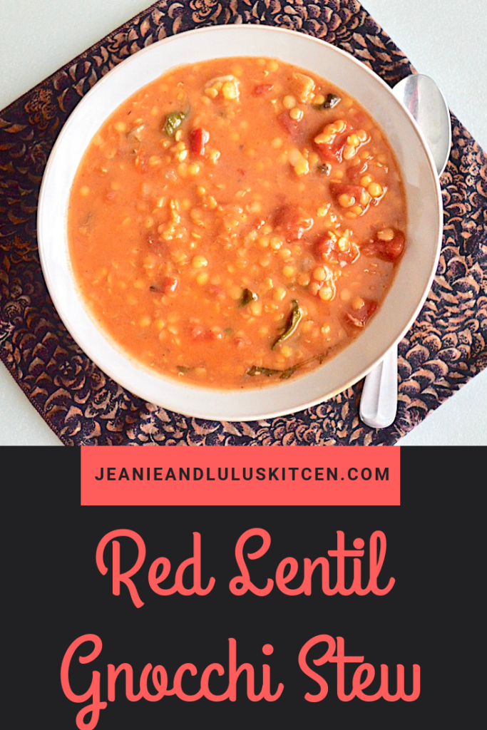 This is such a hearty and warming red lentil gnocchi stew with lots of veggies and fluffy sweet potato gnocchi making it a bowl of pure winter comfort. #stew #lentils #gnocchi #redlentilgnocchistew #jeanieandluluskitchen