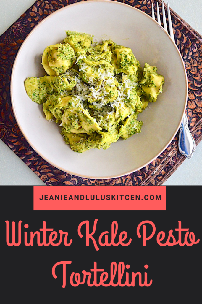 This is such a wonderful winter kale pesto made more substantial with white beans, served over tender cheese tortellini. Perfect for a vegetarian dinner! #pasta #kale #whitebeans #winterkalepesto #jeanieandluluskitchen