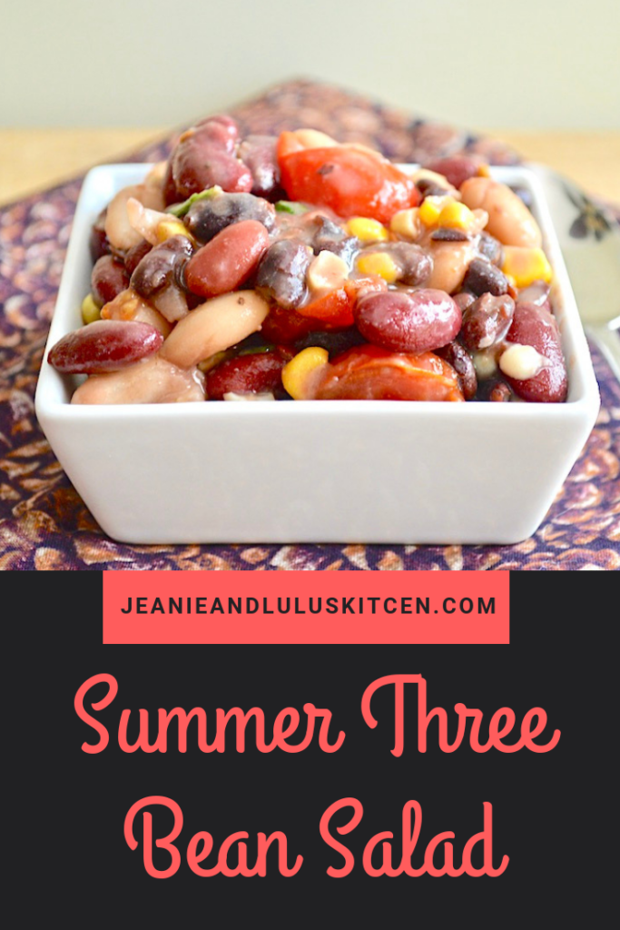 This is such a refreshing and light summer three bean salad packed with roasted corn, cherry tomatoes, basil and lemon dressing! #salad #beans #summer #summerthreebeansalad #jeanieandluluskitchen