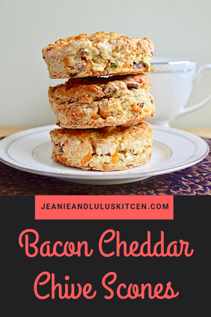 These bacon cheddar chive scones are so buttery, flavorful and wonderful for a savory breakfast or tea time bread! They're a meal in themselves. #scones #bread #baconcheddarchivescones #savoryscones #jeanieandluluskitchen