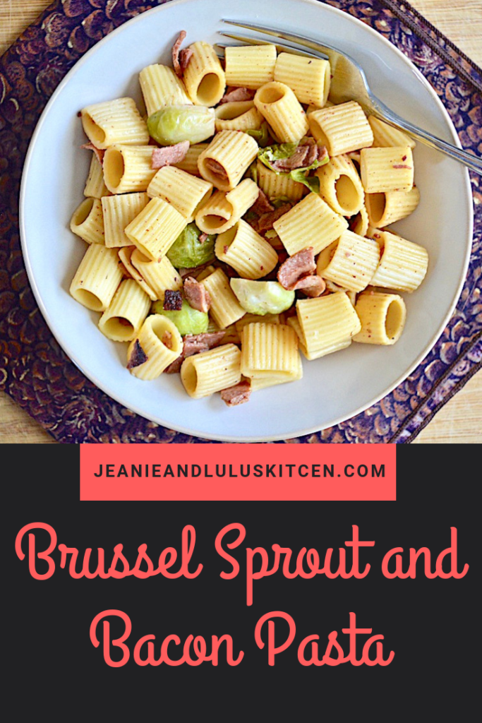 This brussel sprout and bacon pasta is so simple and flavorful! It's my favorite side of brussel sprouts with bacon turned into a complete meal. #pasta #dinner #bacon #brusselsprouts #jeanieandluluskitchen #brusselsproutandbaconpasta
