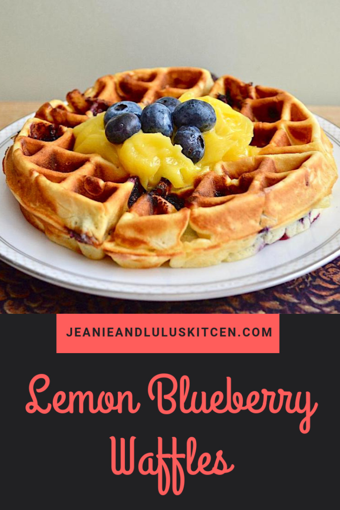 These lemon blueberry waffles are so fresh, bright and fluffy for brunch with the big bursts of juicy blueberries. The lemon curd tops them perfectly! #waffles #breakfast #brunch #lemonblueberrywaffles #jeanieandluluskitchen